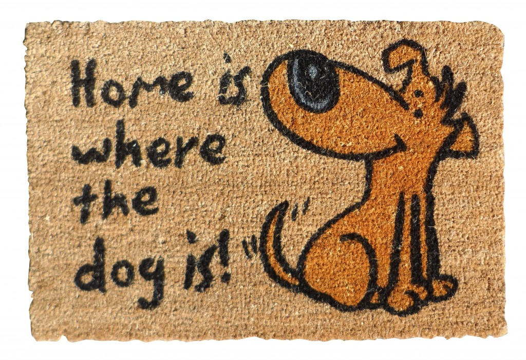 Brown coir mat with the words 'home is where the dog is in black and a yellow cartoon dog.