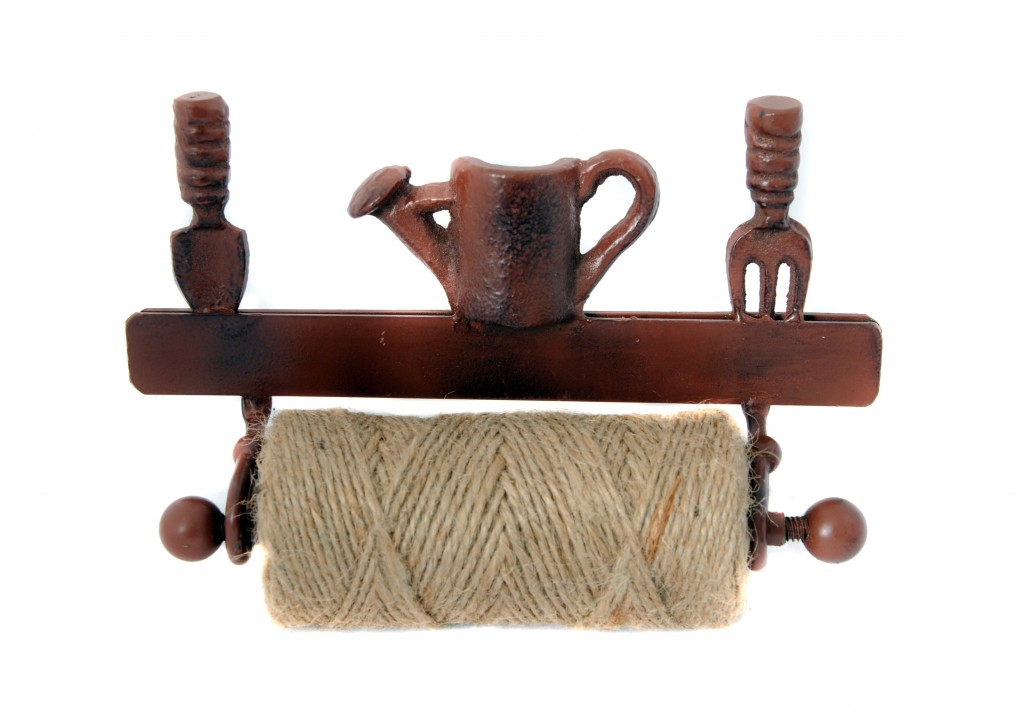 Twine in a rustic style holder with spade, watering can and garden fork detailing on top. Brown holder with cream twine