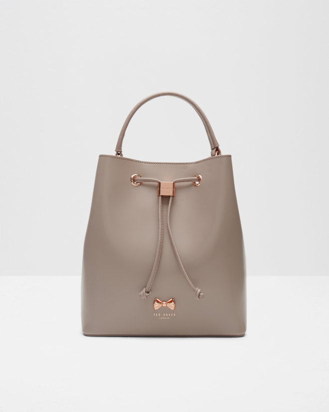 df22c884d9be0f Ted s ADEA bag has buckets of style. Trimmed with a rose-gold ribbon and a  stamp of approval from the man himself
